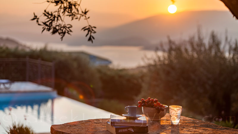 Sunrise above the sea at a luxurious villa in Corfu