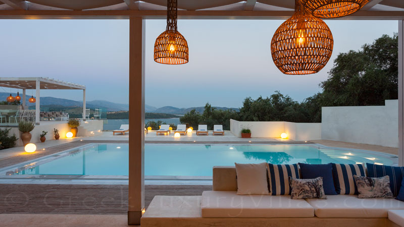 Outdoor lounge of a luxury villa with pool in Corfu
