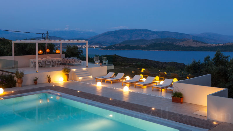The outdoor lounge of the luxury villa with a pool in Corfu