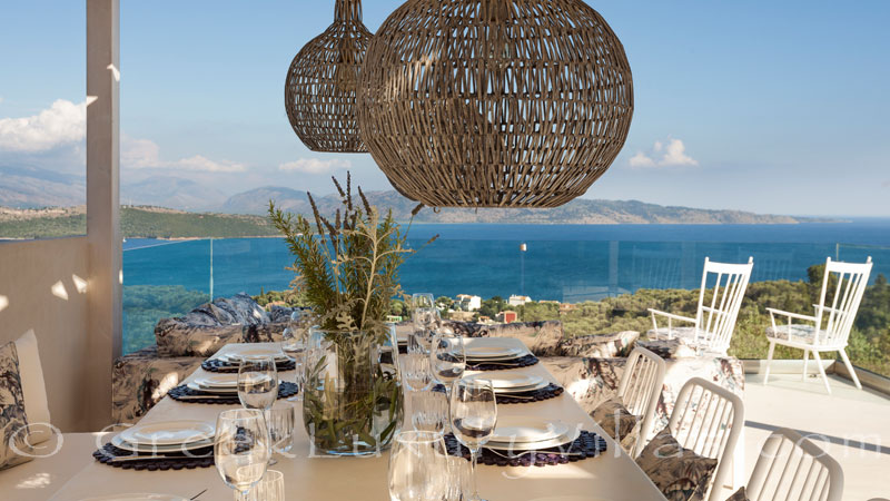 Outdoor dining with seaview at a luxury villa in Corfu