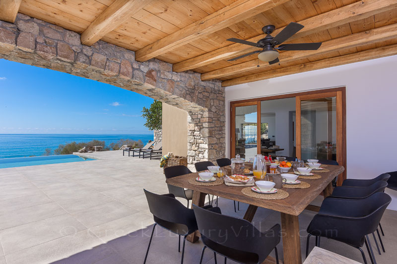Outdoor dining in beachfront luxury villa
