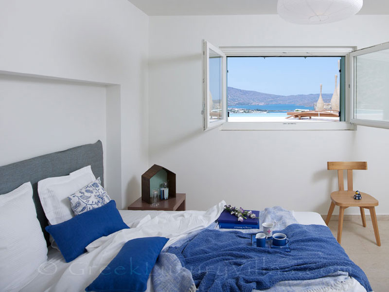 Sunny bedroom in a big luxury villa in Elounda, Crete