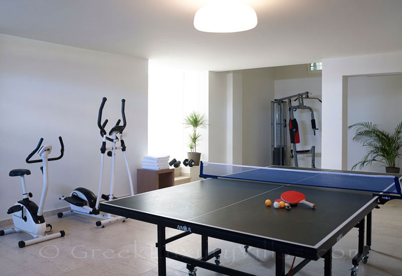 The playroom and the gym of a big luxury villa in Elounda, Crete