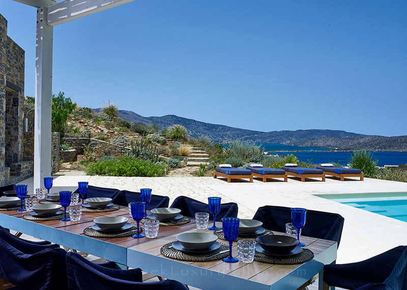 Outdoor dining area with seaview at a luxury villa in Elounda, Crete