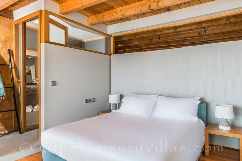 Bedroom of seafront villa with pool in Crete