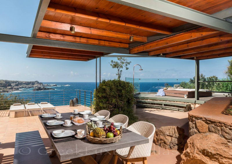 View from outdoor dining area of villa with pool in Crete