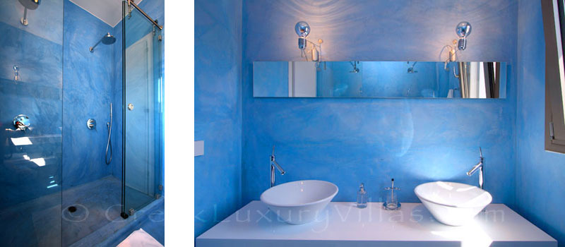 The bathroom of a modern luxury villa with a pool in Elounda