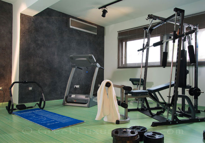 The gym in the modern luxury villa with a pool in Elounda