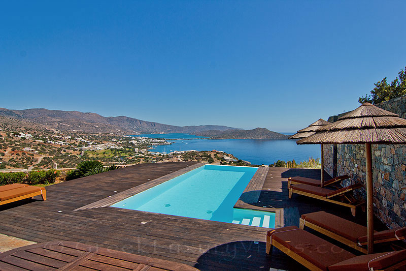 The seaview over Elounda from a modern luxury villa with a pool