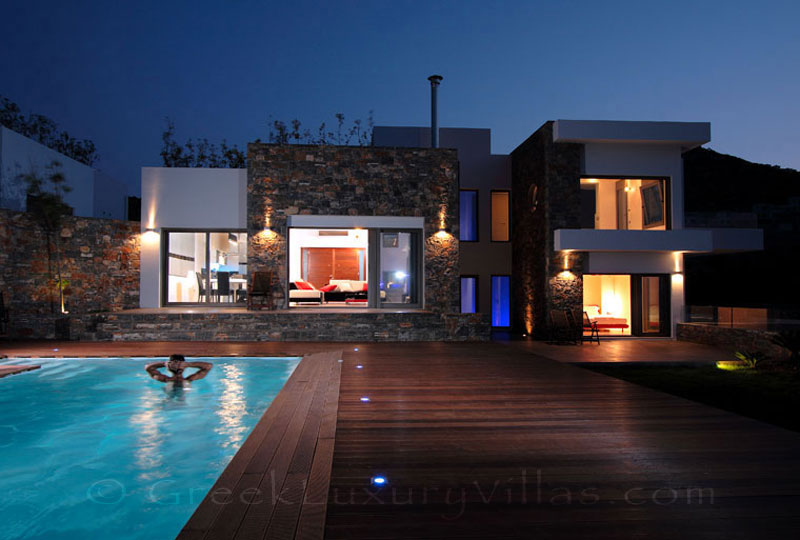 A modern luxury villa with a heated pool