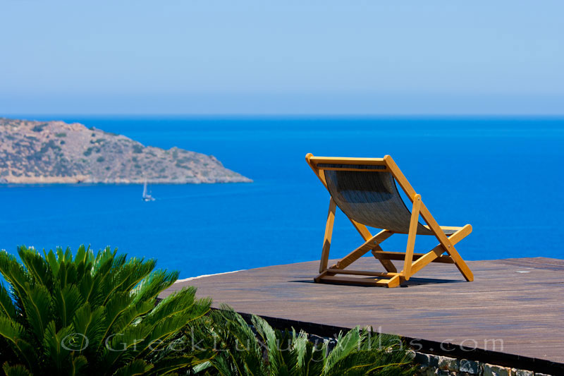 The seaview of Elounda from a modern luxury villa with a pool