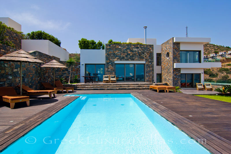 A modern luxury villa with a heated pool in Elounda