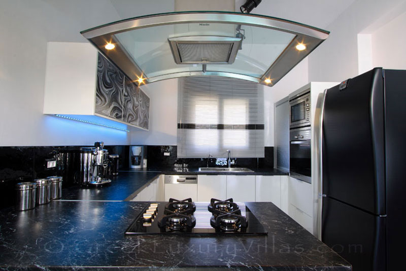A luxury kitchen of the modern luxury villa with a pool