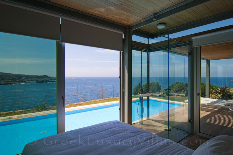 modern seafront villa with pool and amazing sea view from bed