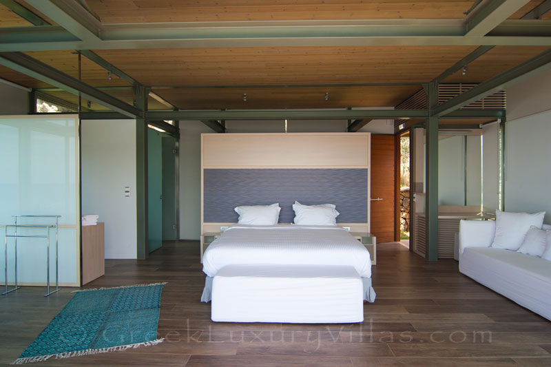 Crete modern seafront villa with pool guesthouse bedroom