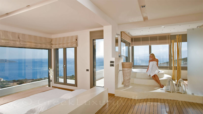 The master bedroom of a modern luxury villa overlooking Elounda bay