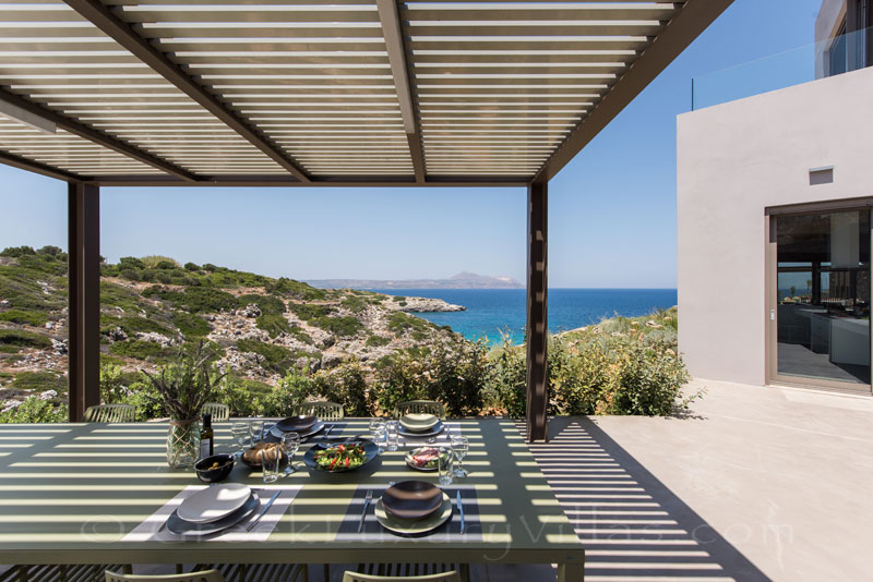 Dining with seaview at the modern villa in Crete
