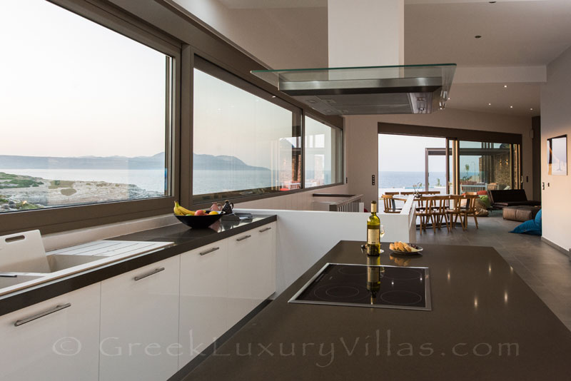 A modern kitchen with seaview in a luxury villa in Crete