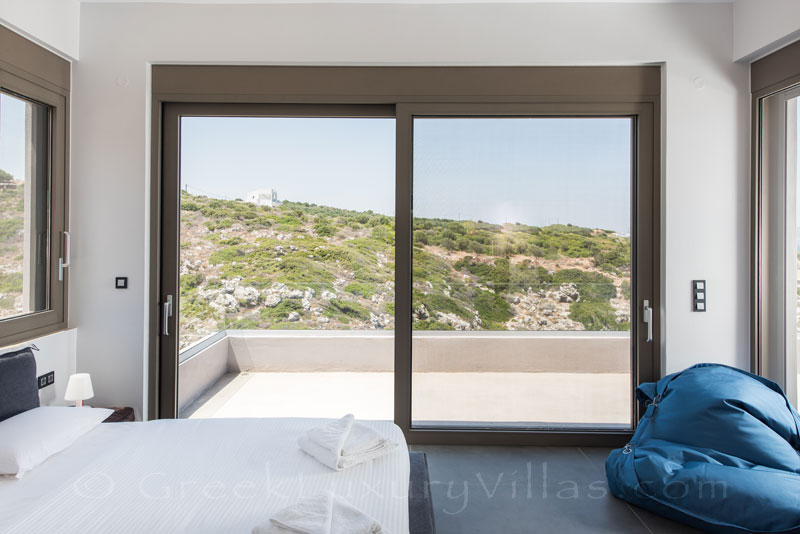 Luxurious bedroom with seaview of a modern villa in Crete