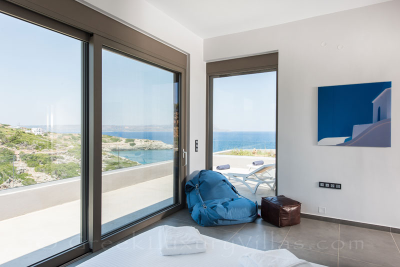A luxurious bedroom with seaview of a modern villa in Crete