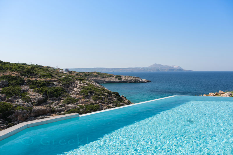 Pool view from the secluded seafront luxury villa