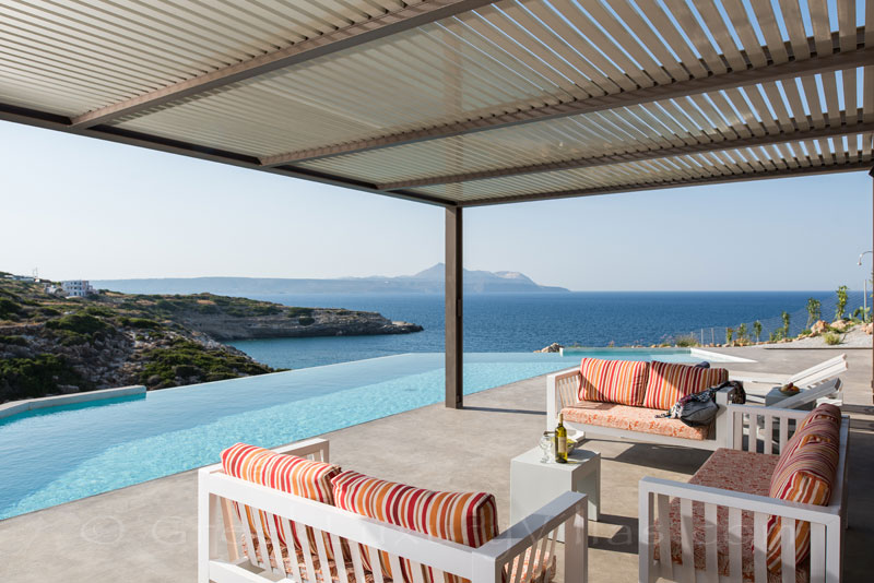 Pool area at the seafront luxury villa in Crete