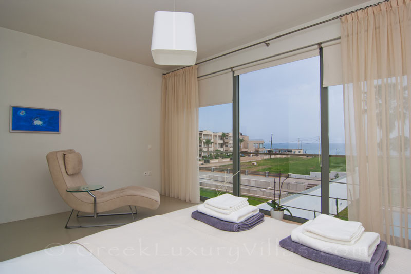 See the beach from your bed in Crete