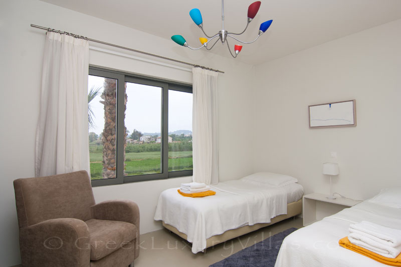 Single beds of a beachfront villa in Maleme, Crete