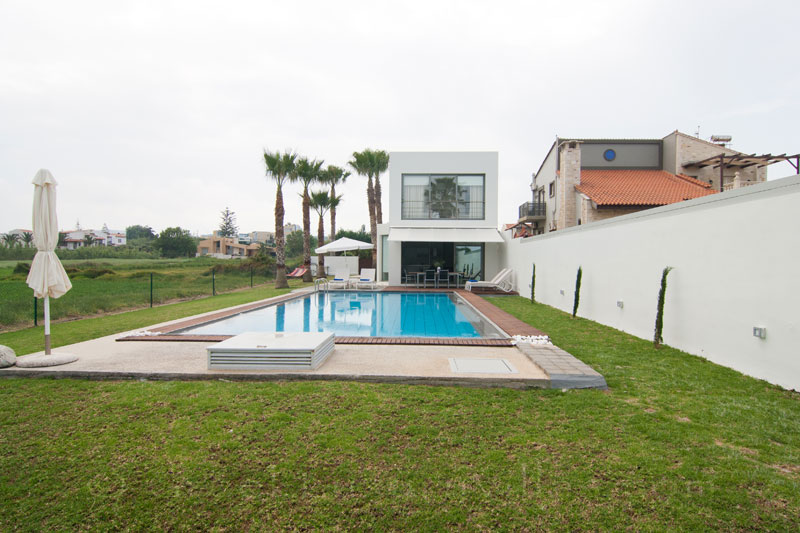 A beachfront villa with a pool in Maleme, Crete