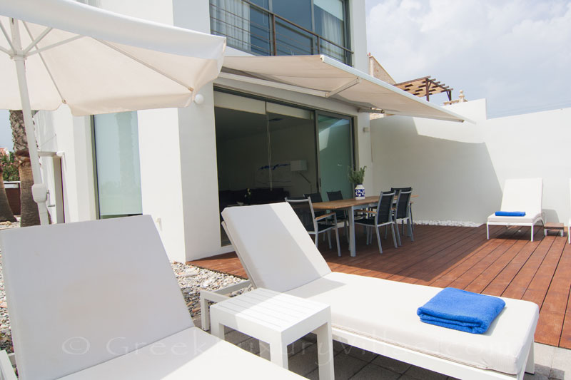 The sunny deck of a beachfront villa in Maleme, Crete