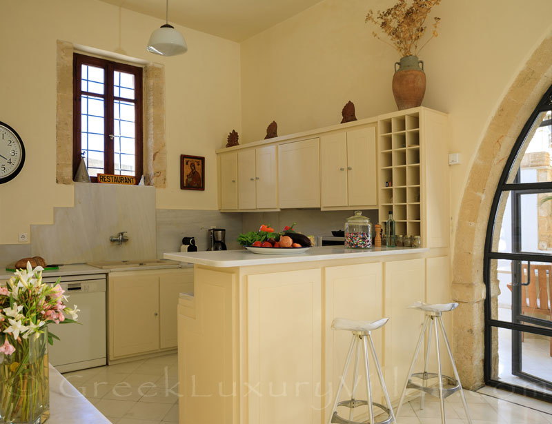 The kitchen of an exclusive historic villa in a traditional village of Crete