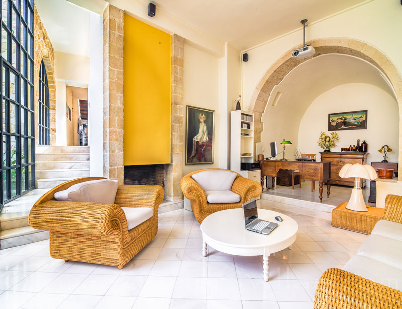 The sunny lounge of an exclusive historic villa in a traditional village of Crete