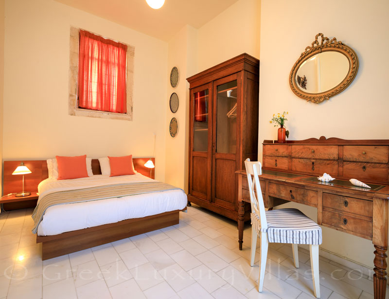 A bedroom of the exclusive historic villa in a traditional village of Crete