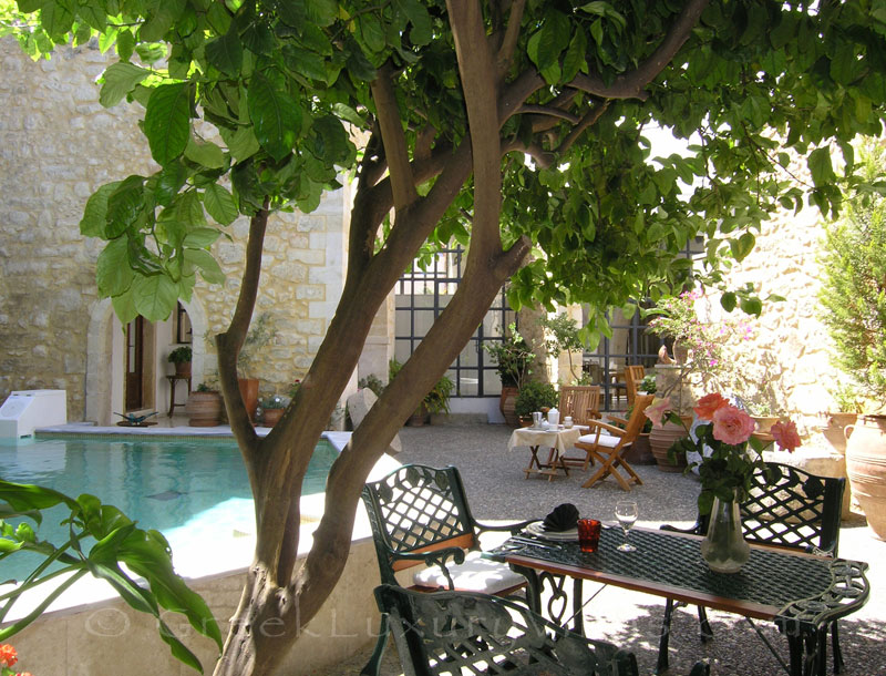 The pool yard of an exclusive historic villa in a traditional village in Crete