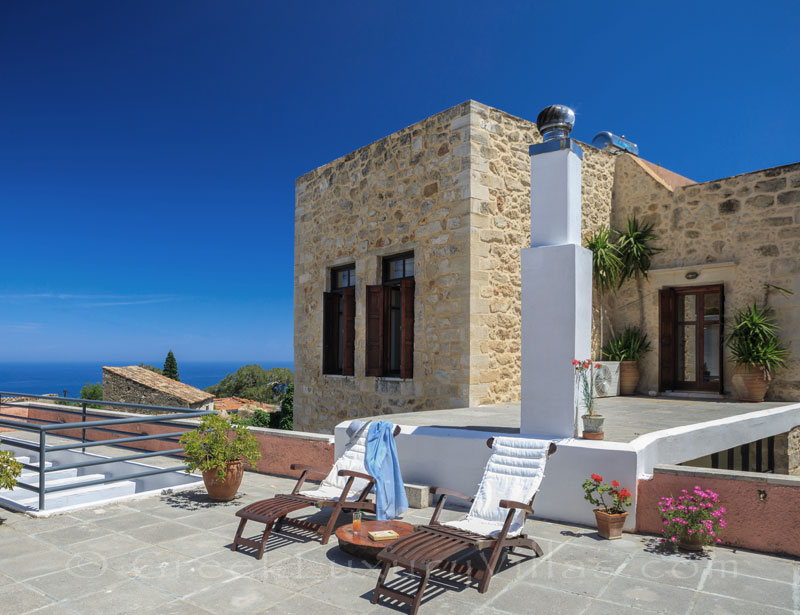 The roof terrace of an exclusive historic villa in a traditional village of Crete
