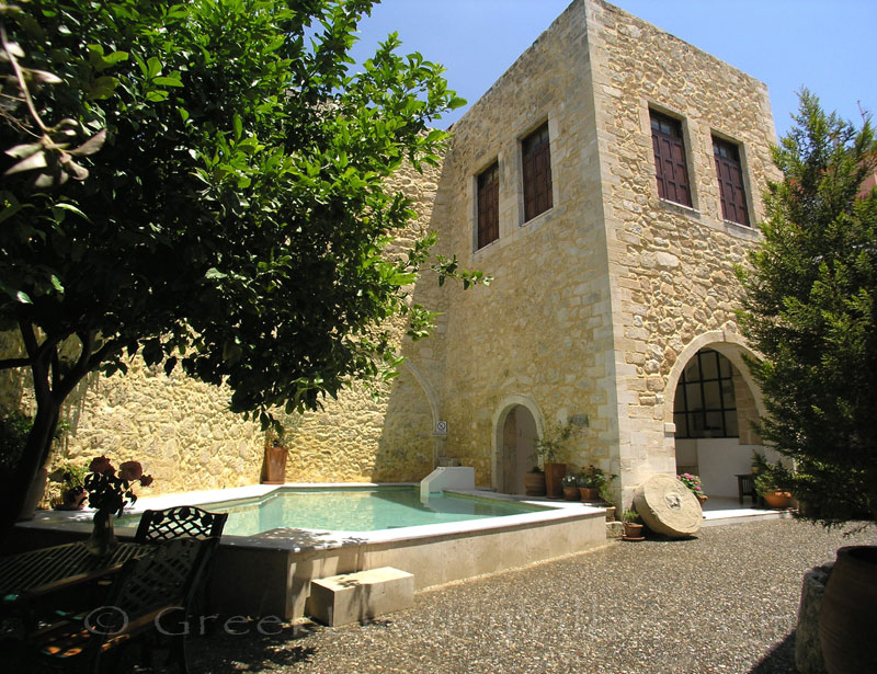 The yard of an exclusive historic villa in a traditional village of Crete