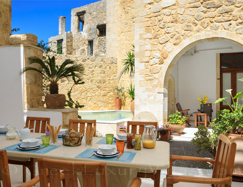 Dining outside at the exclusive historic villa in a traditional village of Crete
