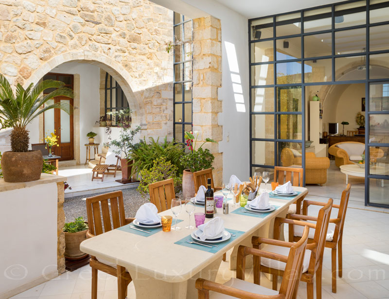 Dining al-fresco at an exclusive historic villa in a traditional village of Crete