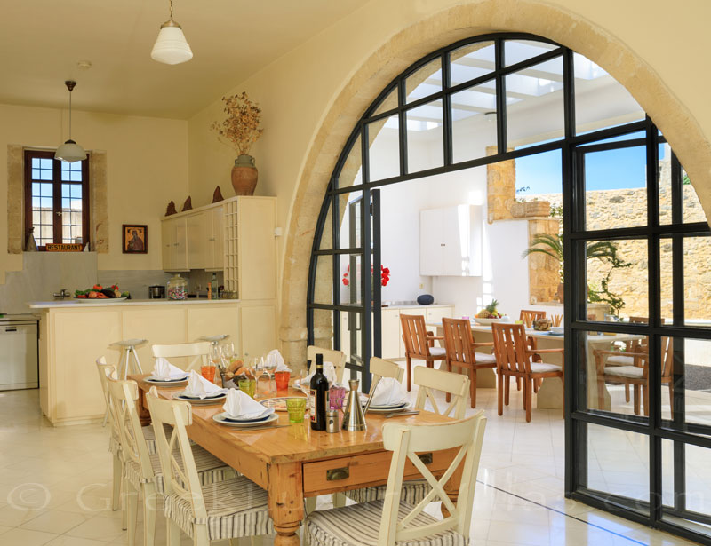 Indoor dining area of the exclusive historic villa in a traditional village of Crete