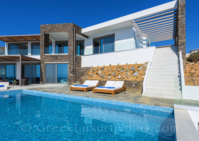 Modern seafront luxury villa with a pool in Crete