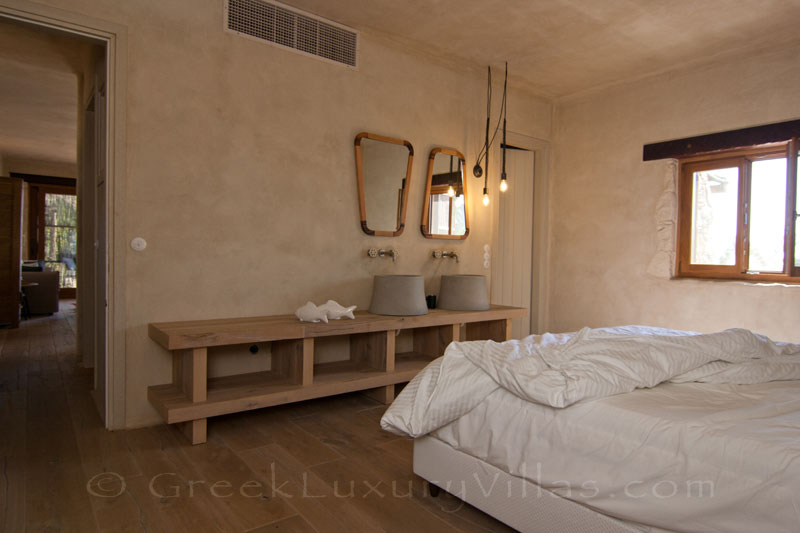 The bedroom of a beach house in Crete