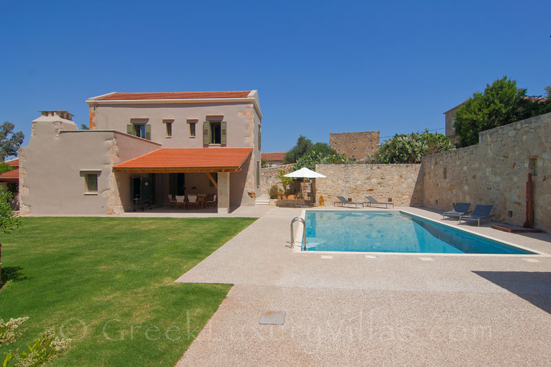 The pool and the garden of a luxury villa with a pool in a traditional village