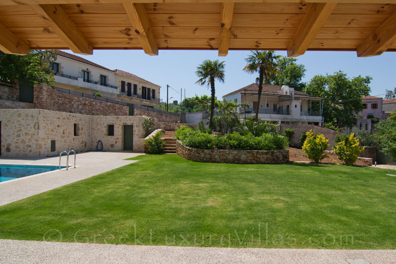 The garden of a luxury villa with a pool in a traditional village