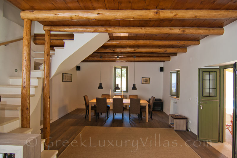 The dining-room of a luxury villa with a pool in a traditional village
