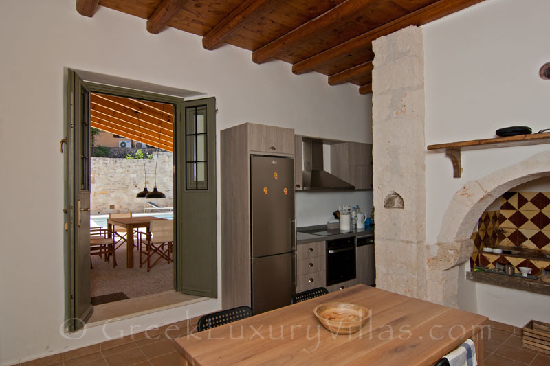 The kitchen of a luxury villa with a pool in a traditional village