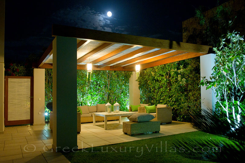 Outdoor lounge area of island style seafront villa in Almyrida Crete
