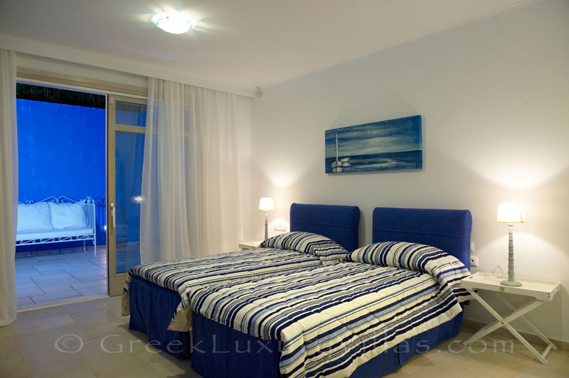 Bedroom of island style seafront villa in Almyrida Crete