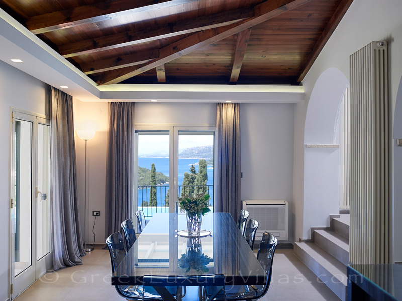 dining room with sea view of luxury villa in Sivota
