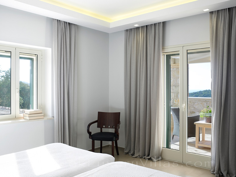 modern bedroom of luxury villa in Sivota
