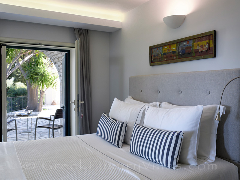 bedroom with access to terrace of luxury villa